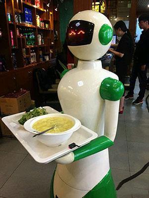 什么是餐厅机器人,它与餐饮服务机器人什么关系?